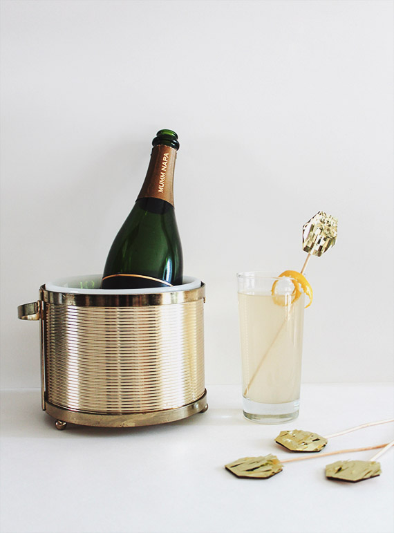french 75s and gold fringe drink toppers