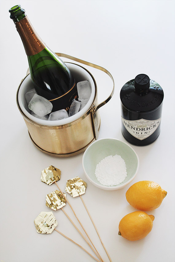 french 75s with gold fringe drink toppers