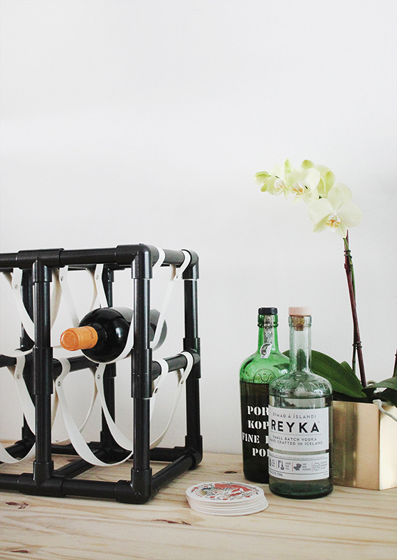 diy pipe + leather wine rack
